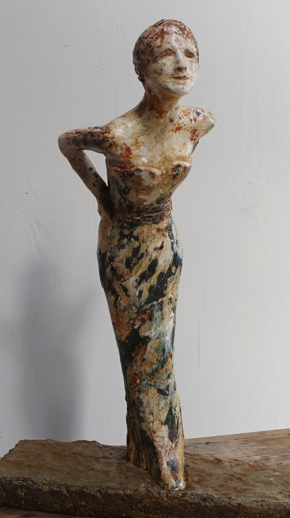 woman in the mirror  cast concrete+plaster, tint, patina, torch   20 x 15 x 6 inch (51 x 38 x 15 cm)     inspired by Richard Avedon photograph of the model Dorian Leigh